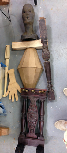 Piano pedal mechanism, staved vessel halves, turned table leg, newel post, carved head and hand by Keith Holt. We found all this on the resource table.