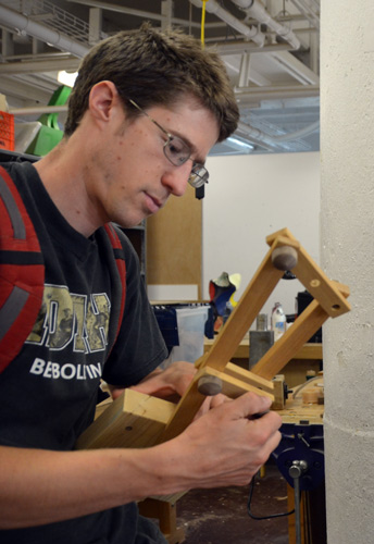 Ben tries John's four-bar linkage, finding that it rotates easily and assumes some surprising positions.