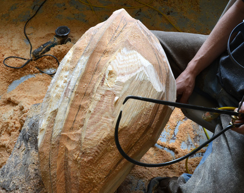 Ben's caliper indicates he has made the wood too thin in the belly of the boat shape he's been chain-saw carving all day.