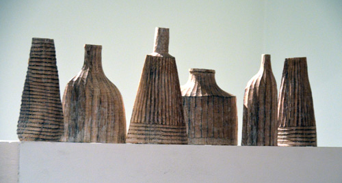 Arranging the carved bottle forms on a railing reveals their ascent from still-life paintings by Giorgio Morandi