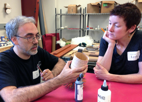 Ed Kelle discusses an idea with Leah Woods, in the painting studio.