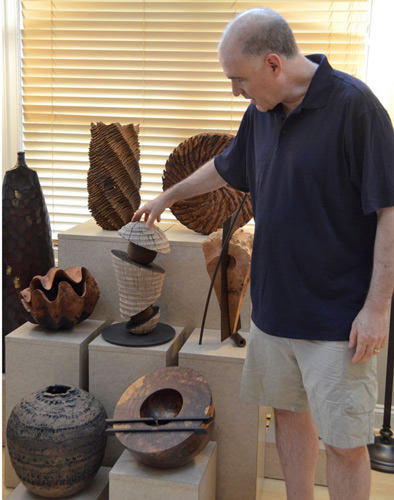 Jeff Bernstein selects a Todd Hoyer sculpture from the main grouping in the family's great room.