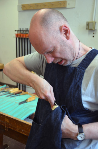 """Malcolm Martin responds to the """"turning"""" and """"vessel"""" aspects of our residency by carving and sewing a small bottle."""