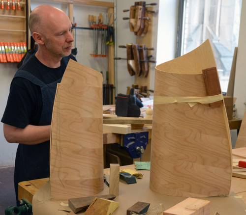 Malcolm tapes up a new cluster of forms using the bending plywood, a new material to him and Gaynor.