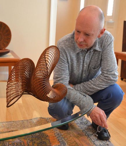 Malcolm is entranced by this basketry sculpture, also from Japan.