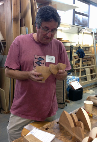 Mark Sfirri considers some wood bits. Mark is head of the woodworking program at Bucks County Community College, and an avid Echo Lake participant.