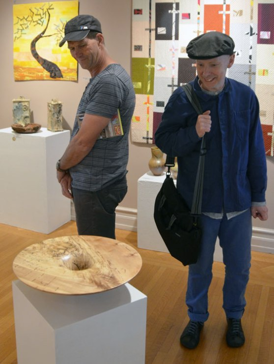En route to Phil Brown's we pause to see the 29th biennual juried exhibition of the Creative Crafts Council at the Strathmore Mansion in Bethesda. Neil Turner and Malcolm Martin don't seem surprised to encounter a piece by Phil, judged first place in the wood division.