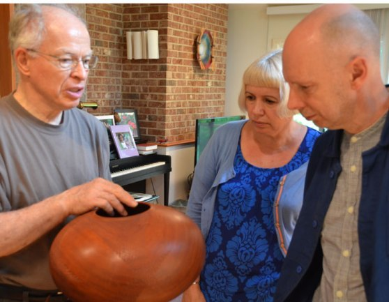Our host Phil Brown of the Montgomery County woodturners has a very fine collection of contemporary work. Here he explains the exacting proportions of an imposing turned-and-carved vessel by Hilliard Booth.