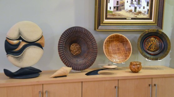 And a lot of it is ab out art in wood, like this grouping thst includes work by Betty Scarpino, Harvey Fein and
