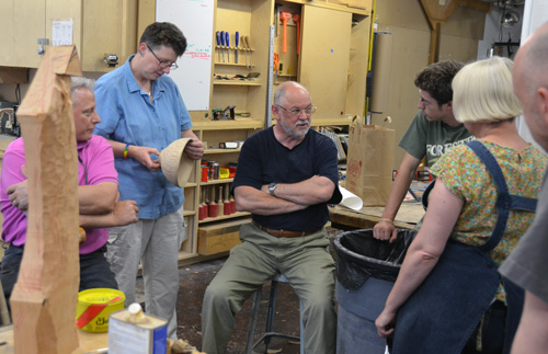 Albert, Eli and Terry discuss a bowl that Ben Carpenter turned, and Gaynor Dowling decorated by carving on the outside. Gaynor used one of the gigantic OneWay lathes as a work-holding mandrel.
