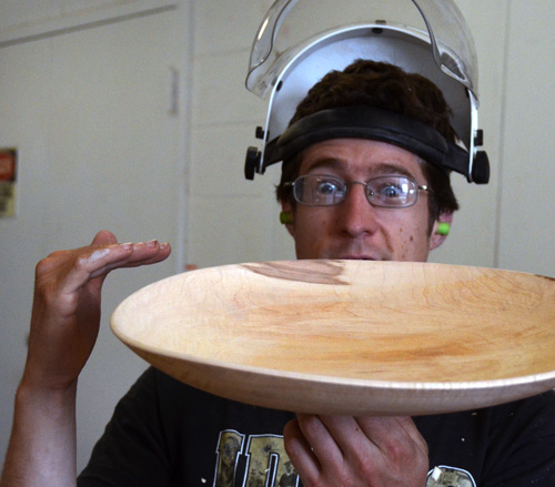 Ben Carpenter is surprised by how quickly this green-turned plate begins to warp and distort.
