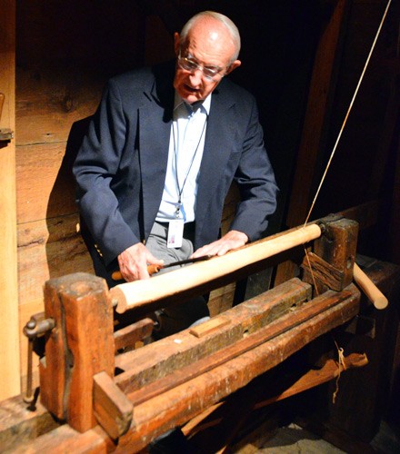 A smaller lathe, powered by  the turner himself by way of a treadle and spring pole, was used for spindle work.
