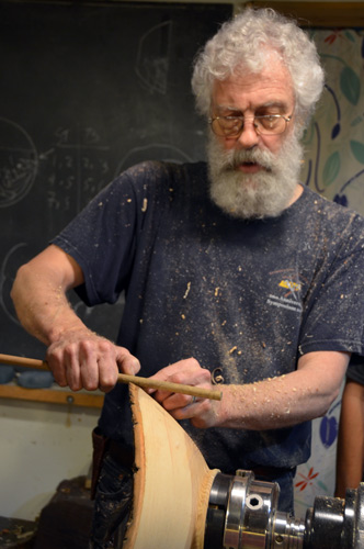 Though he is best known as an artist, David teaches 18 weekends a year, five students each time. He gives many excellent, low-tech methods, such as this stick trick for locating the bottom of the bowl.