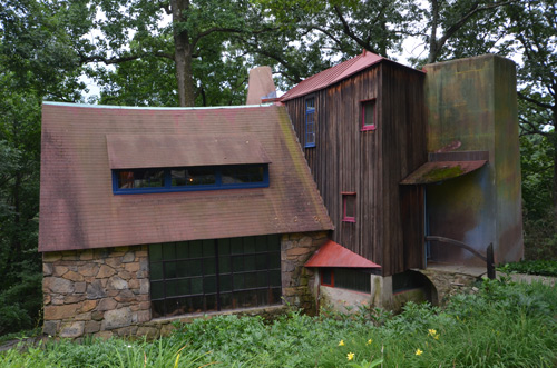 Wharton Esherick museum from the outside. The curves and leans off vertical aren't creeping old age, they're how he designed and built the place.