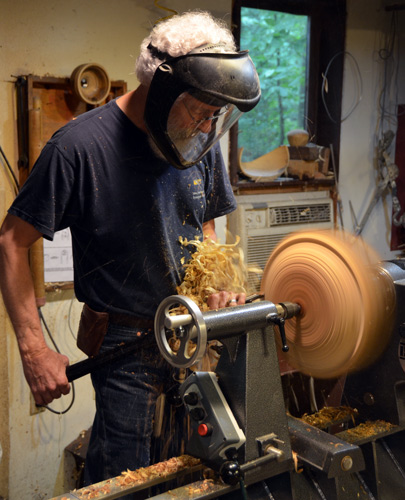 David balances the blank between centers and attacks it with his signature swept-back gouge. He works from the flattish face toward the rough chainsawn octagon. This strategy keeps the tool in the wood, enabling a heavy cut.