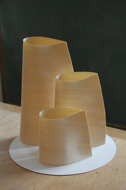 A group of three poplar pieces on what will be a wood base, the poplar holds a lot of light.