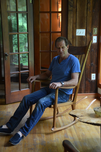 Neil Turner fulfills a dream: he gets to sit in a Sam Maloof rocking chair. Many years ago Sam swapped with David, the chair in exchange for a group of turnings.