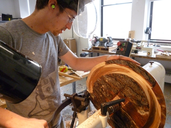 Possibly inspired by our Ellsworth trip, Ben starts on a big natural edged bowl. Here he's preparing to core out the middle, to save the inside to use on another piece.