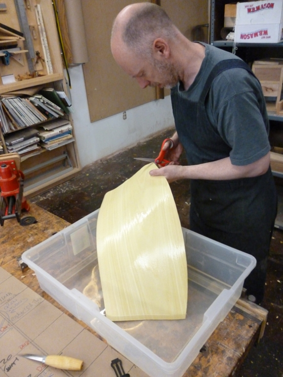 This veneer is remarkably flexible, and a short soak in water  makes it even more so. Here's Malcolm cutting a vessel shape with scissors.