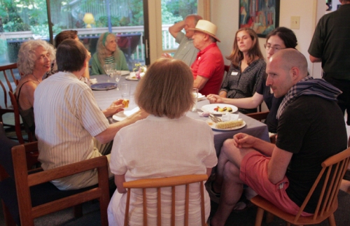 Another table of lively conversation includes