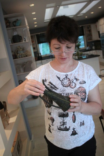 Zina examines the incredible wooden teapot collection.