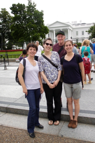Fellows Zina, Julia, Grant and Adrien pose for the quintessential Washington, D.C. photo in front of The White House.