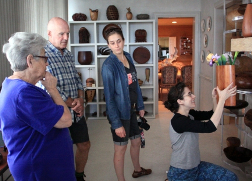 Fleur speaks of her collection to Grant, Adrien, and Julia.