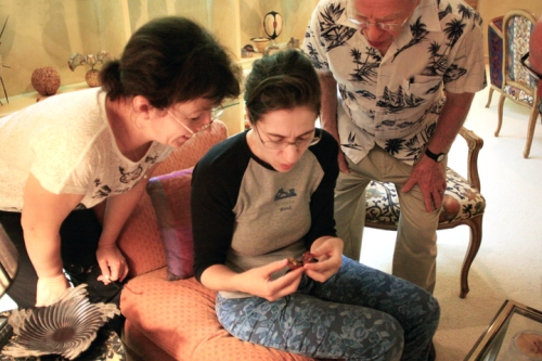 Zina, Julia and Phil are amazed at the incredible carving work found on such tiny pieces.