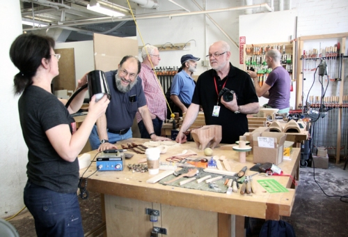 Zina tries to repair her lamp while Joe Seltzer, past ITE fellow and Australian artist, instructor, Terry Martin.